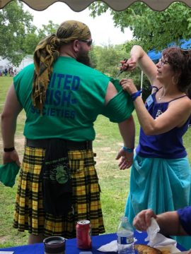 And you thought Librarians only put books on the shelves. Sharon Cross, Library Member, helps at the Highland Games.