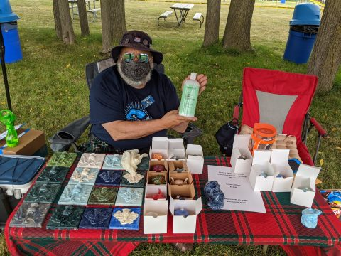 One of our vendors showing off their goods.